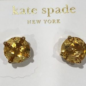Kate Spade gold post earrings.